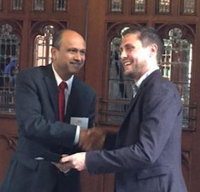 Adam Brockett receives teaching award from Dean Kulkarni